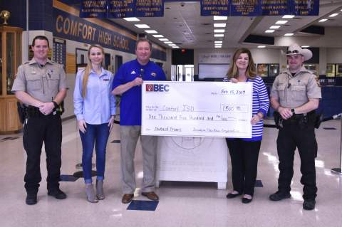Bandera Electric Cooperative representative Lauren Salazar, second from left, presented a $1,500 check for the Shattered Dreams Project at Comfort High School. From left, Kendall County Sheriff's Deputy Tucker Webb, Salazar, CHS Principal Darren William