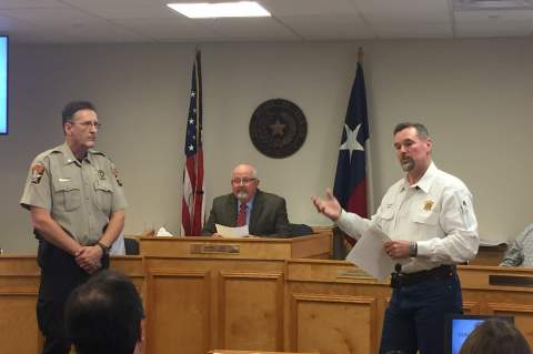 Star photo by Elena Tucker                      Sheriff Al Auxier, right, introduces his new Patrol Lieutenant Kevin Reser to Commissioners Court