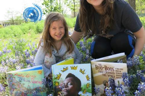 Fairyn Clements and Melody Gartner enjoy Bluebonnet Award Nominee books among the blue bonnets.