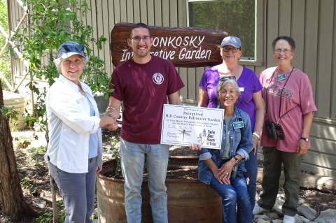 """On hand for the presentation of a """"Pollinator Champion"""" sign at Kreutzberg Canyon Natural Area, were, from left, Veronica Hawk, Daniel Vetter, Cecilia Fuentes, Rheda Boardman and Molly Houch. Also on hand were Dale Bransford and Ken Butler"""