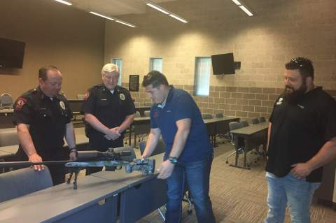 """""""The object is never to have to use it,"""" Paul Duran of Apache Rifleworks said, upon presenting a custom sniper rifle to Boerne Police Chief Jim Kohler and Assistant Chief Jeff Page. The new firearm is for the specialized use of the BPD's Emergency Response Team. Star photo by Elena Tucker"""
