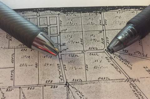 A historical map shows the location of the two gas stations.