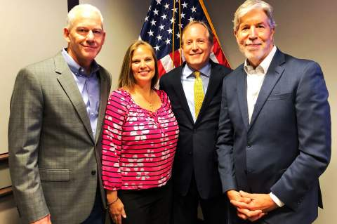 Boerne's Mayor-elect Tim Handren, left, Kendall County Precinct 1 Commissioner Christina Bergmann and Boerne lakeside property owner Mike Malley, right, met with Texas attorney general Ken Paxton in Austin last week.