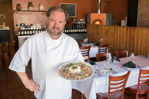 Chef Keith Kuhn, holding an aged prosciutto appetizer, brings his love of Italian food and culture to Boerne tables at Valeria, 109 Waterview Pkwy. After a successful round of classes covering Old World Grains, Kuhn plans to host the next series of cooking classes this summer.