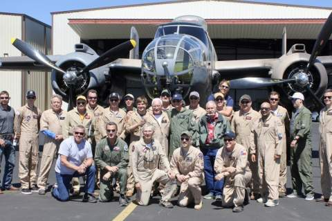 "Terry Adams center of group shot at the Gillespie County Airport April 14. Boerne Resident, Adams, pulled together a beautiful tribute to Dick Cole, he recruited 11 fellow AT-6 ""Texan"" pilots for the Memorial Flyover.  Photo credit Lucky Lindy"