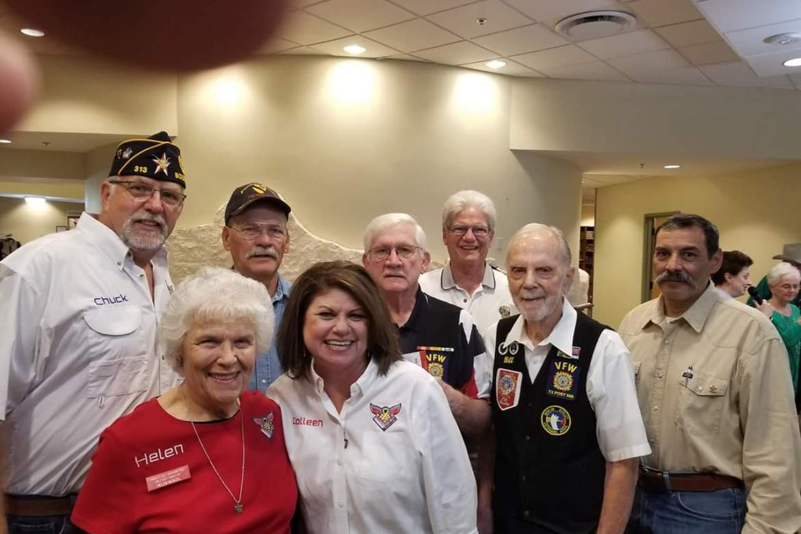 """From left, back row - Chuck Brower, American Legion Post 313, Grant Meadows, Herman Floyd, Bill Mayo, and Dave Judson, VFW Post 688 and Ron Cortez, Kendall County Veterans Service Officer; front row - Helen Wenzel and Colleen Voigt of Angels All Around You Military Ministry. Also there supporting the Veterans were Shedell Giddens of Alamo Hospice and Lydia Smith with """"Drover"""" from Paws for Hearts working therapy dogs."""