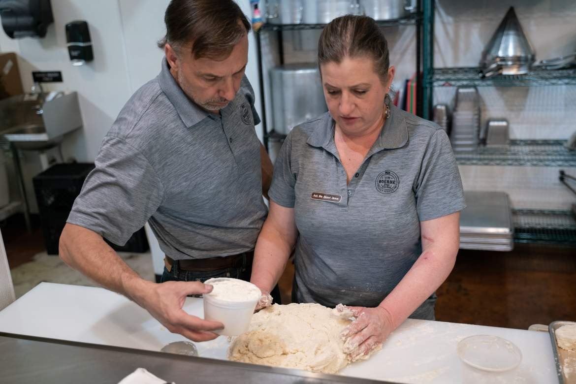 Boerne Soup Kitchen owners Lonnie and Kathleen Wright work together to make gluten-free biscuits for biscuits and gravy. BSK celebrated their six month anniversary April 10.
