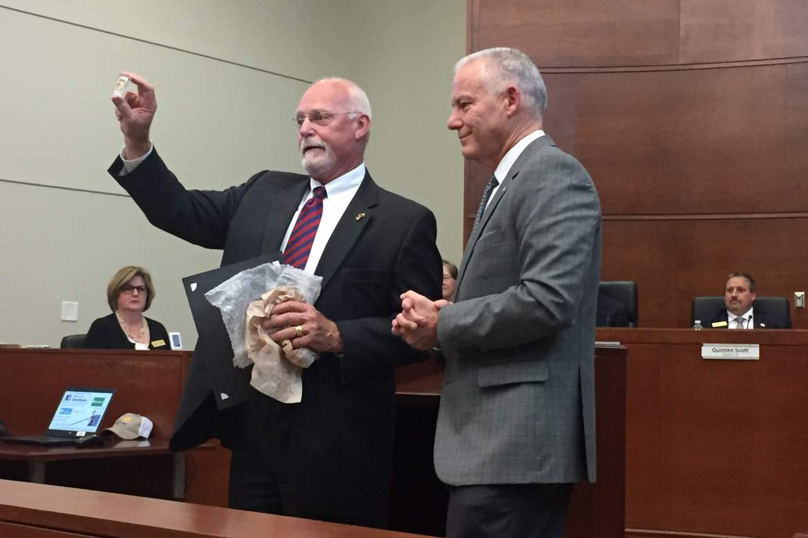 "Outgoing mayor Mike Schultz, presents new mayor Tim Handren with a copy of a ""City of Boerne - Mayor"" lapel pin that he has worn for his past two terms in office. Star photo by Elena Tucker"